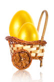 Painted in gold color eggs in the basket. Easter golden eggs in a wicker basket stroller Stock Images