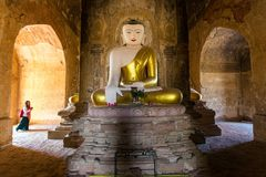 Painted and golden Buddha in Myanmar Stock Photo