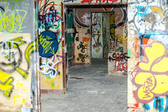 Painted graffiti in an abandoned factory building. Painted graffiti in an abandoned factory building Royalty Free Stock Photos