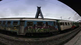 Painted graffiti train leaving main train station in Bologna, Italy. Full HD stock footage