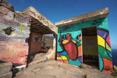 Painted graffiti on the wall of an abandoned building Stock Photo