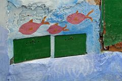 Painted Graffiti Wall with fishes in blue on old house in the medina of Tétouan, Morocco stock photo