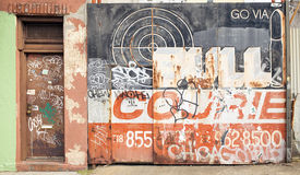 A painted and graffitied garage door in Dumbo, New York City. A painted and graffitied garage door royalty free stock image