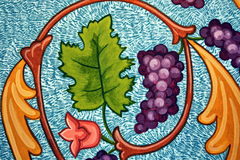 Painted grapes and leaves Stock Photo