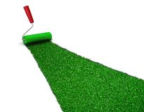 Painted green grass. Image of paint roller painting green grass over white Stock Photo