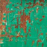 Painted green rusty metal surface Stock Photos