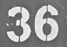 36 painted on grey Stock Image