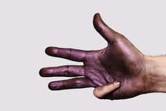 Painted Hand with four Fingers. Isolated on gray Background royalty free stock images