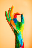 Painted hand with OK sign, colorful fun. Royalty Free Stock Image
