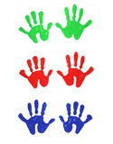 Painted hand prints. Multi-colored finger painted hand prints of children ( image Stock Photo
