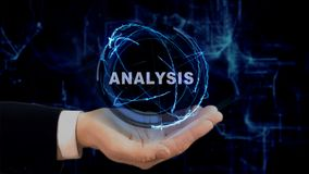 Painted hand shows concept hologram Analysis on his hand. Drawn man in business suit with future technology screen and modern cosmic background Royalty Free Stock Photo