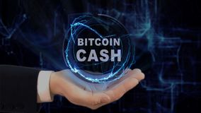 Painted hand shows concept hologram Bitcoin cash on his hand. Drawn man in business suit with future technology screen and modern cosmic background Stock Images