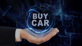 Painted hand shows concept hologram Buy car on his hand. Drawn man in business suit with future technology screen and modern cosmic background Stock Photos