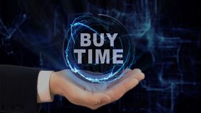 Painted hand shows concept hologram Buy time on his hand. Drawn man in business suit with future technology screen and modern cosmic background Stock Photo