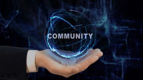 Painted hand shows concept hologram community on his hand. Drawn man in business suit with future technology screen and modern cosmic background stock images