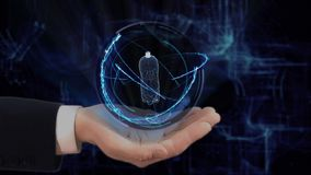 Painted hand shows concept hologram 3d bottle on his hand. Drawn man in business suit with future technology screen and modern cosmic background stock footage