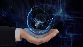 Painted hand shows concept hologram 3d skull on his hand. Drawn man in business suit with future technology screen and modern cosmic background stock video