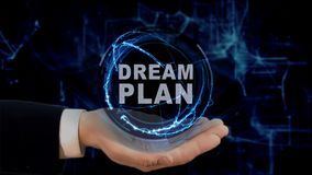 Painted hand shows concept hologram Dream plan on his hand. Drawn man in business suit with future technology screen and modern cosmic background Stock Images