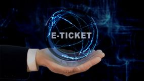Painted hand shows concept hologram E-ticket on his hand. Drawn man in business suit with future technology screen and modern cosmic background Stock Photos