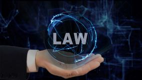 Painted hand shows concept hologram Law on his hand. Drawn man in business suit with future technology screen and modern cosmic background Stock Photography