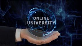 Painted hand shows concept hologram Online university on his hand. Drawn man in business suit with future technology screen and modern cosmic background Stock Image
