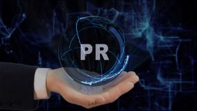 Painted hand shows concept hologram PR on his hand. Drawn man in business suit with future technology screen and modern cosmic background Stock Photos