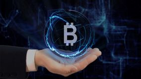 Painted hand shows concept hologram Sign BTC on his hand. Drawn man in business suit with future technology screen and modern cosmic background Stock Photos