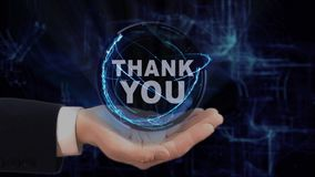 Painted hand shows concept hologram Thank you on his hand. Drawn man in business suit with future technology screen and modern cosmic background stock video