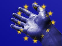 Painted hand in the style of the european union flag royalty free stock images