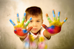 Painted hands. Child showing his painted hands stock image