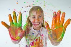 Painted Hands. A happy child with paint covered hands and a big smile Royalty Free Stock Photo