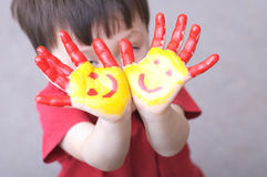 Painted hands of child Stock Images