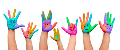 Painted hands. Hands painted with colours and happy smilies, happy faces Royalty Free Stock Photo