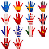 Painted hands. Multiple hands with flags painted on them Stock Photos