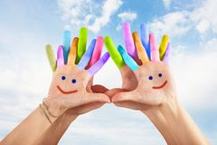 Painted hands with smile Stock Photos