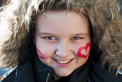 Painted happy child. With heart and kiss on cheeks Royalty Free Stock Photos