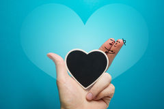 Painted happy fingers smiley in love with blackboard heart Stock Photo