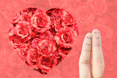 Painted happy fingers. Smiley in love and rose background stock photography