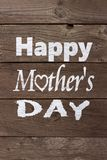 Painted Happy Mothers Day text on old wood Royalty Free Stock Photos