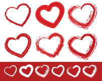 Painted heart shapes. Set of 6 different grungy contour lines of Stock Image