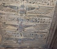 Painted hieroglyphic carvings on an ancient egyptian temple wall royalty free stock photography