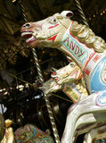 PAINTED HORSES ON VICTORIAN STEAM DRIVEN FAIRGROUND RIDE. IN CLOSE UP Royalty Free Stock Photo