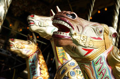 PAINTED HORSES ON VICTORIAN STEAM DRIVEN FAIRGROUND RIDE. IN CLOSE UP Royalty Free Stock Images