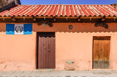 Painted house & Guatemalan flag, Antigua, Guatemala Royalty Free Stock Images
