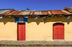 Painted house & Guatemalan flags, Antigua, Guatemala royalty free stock photo