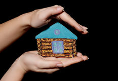 Painted house in hands Royalty Free Stock Photo