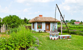 Painted house and shadoof. The village of Zalipie & x28;Poland& x29; is well known of its original painted houses and farm buildings, decorated with flower Stock Photography