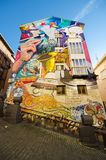 The Painted houses with  artistic graffitties murals Stock Image