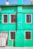 Painted houses in Venice. Colorful beautiful green house in Venice, Italy Stock Photography