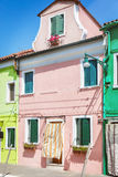 Painted houses in Venice. Colorful beautiful pink house in Venice, Italy Stock Photo